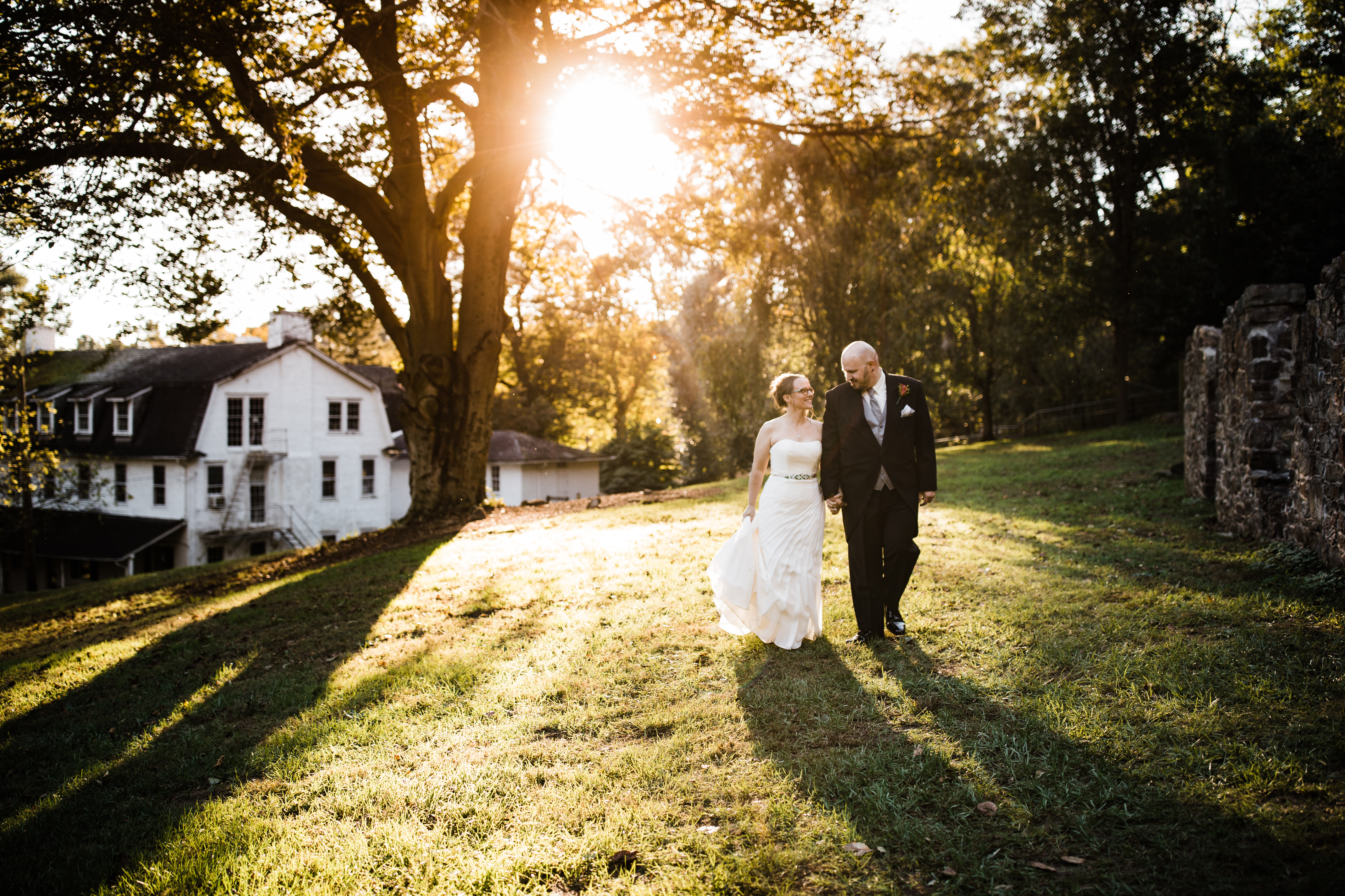 Historic Yellow Springs Bride walking in and groom golden hour